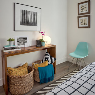 Bedroom - small contemporary guest medium tone wood floor and brown floor bedroom idea in San Francisco with white walls
