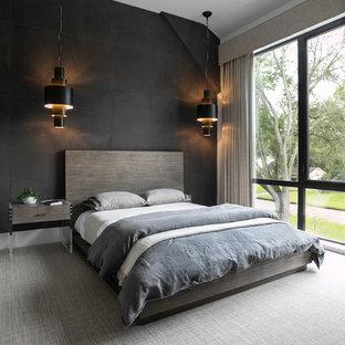 ヒューストンのコンテンポラリースタイルのおしゃれな寝室 (黒い壁、カーペット敷き、グレーの床) のインテリア