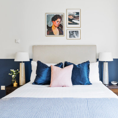 Inspiration for a contemporary bedroom remodel in London with blue walls