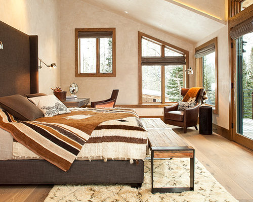 Charming Example Of A Trendy Bedroom Design In Denver With Beige Walls And Light  Hardwood Floors