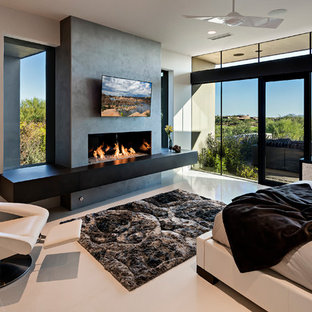 Large modern master bedroom in Phoenix with beige walls, porcelain floors, a ribbon fireplace and a concrete fireplace surround.