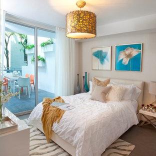 Bedroom - contemporary bedroom idea in Miami with beige walls