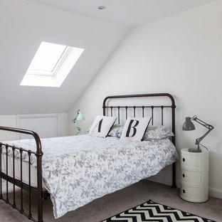 Mid-sized farmhouse guest carpeted bedroom photo in London with white walls