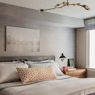 Example of a mid-sized midcentury modern master medium tone wood floor bedroom design in Boston with gray walls