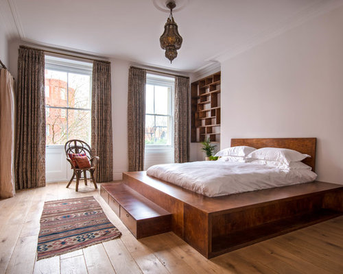 Amazing Inspiration For A Mid Sized Mediterranean Light Wood Floor And Beige Floor  Bedroom Remodel In