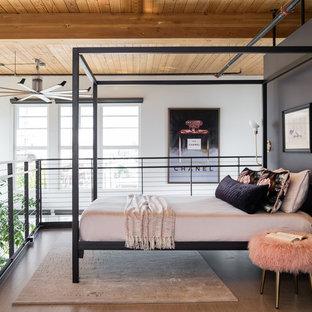 Foto de dormitorio tipo loft, actual, con paredes negras, suelo de cemento y suelo gris