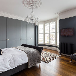 Inspiration for a contemporary grey and pink bedroom in London.