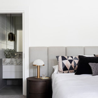 Photo of a mid-sized contemporary master bedroom in Melbourne with white walls, carpet and grey floor.
