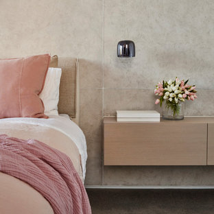 Inspiration for a contemporary bedroom in Melbourne with beige walls, carpet and grey floor.
