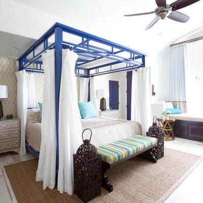 Bedroom - mediterranean painted wood floor bedroom idea in Houston with beige walls and no fireplace