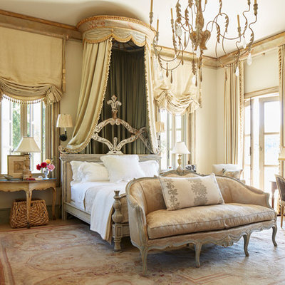 Example of a tuscan master bedroom design in Los Angeles with beige walls and no fireplace