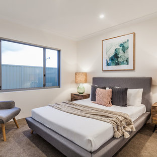 Photo of a contemporary bedroom in Perth with white walls, carpet and beige floor.