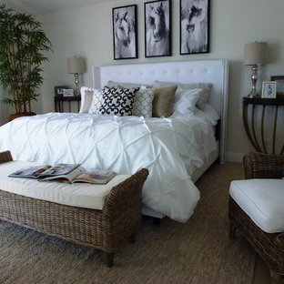Inspiration for a mid-sized contemporary master bedroom remodel in Miami with white walls
