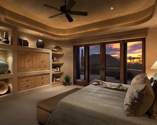 Inspiration For A Mid Sized Southwestern Master Carpeted Bedroom Remodel In  Phoenix With Beige Walls