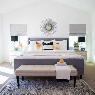 Inspiration for a large midcentury modern master carpeted and beige floor bedroom remodel in Phoenix with white walls