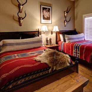 Example of a southwest guest bedroom design in Austin with beige walls