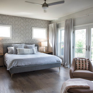 Bedroom - mid-sized transitional master vinyl floor and brown floor bedroom idea in Other with gray walls, a standard fireplace and a stone fireplace