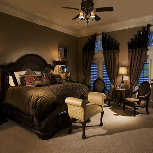 This is an example of a traditional master bedroom in Orlando with brown walls, carpet and beige floor.