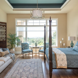 Example of a classic dark wood floor bedroom design in Austin with beige walls
