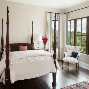 Tuscan guest dark wood floor and brown floor bedroom photo in Austin with beige walls and no fireplace