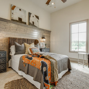 Inspiration for a mid-sized mediterranean guest porcelain floor bedroom remodel in Dallas with beige walls, a standard fireplace and a stone fireplace