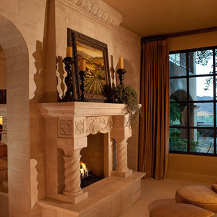 Example of a huge classic master terra-cotta tile bedroom design in Phoenix with brown walls, a two-sided fireplace and a stone fireplace