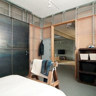 Bedroom - industrial concrete floor bedroom idea in Salt Lake City