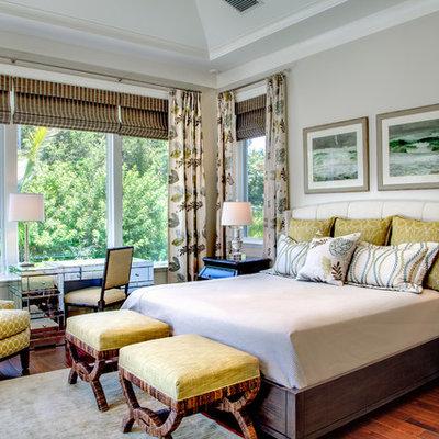 Example of an island style dark wood floor bedroom design in Tampa with gray walls