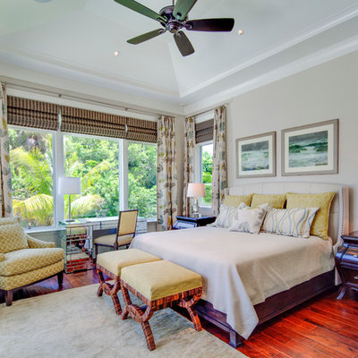 Island style red floor bedroom photo in Tampa with gray walls