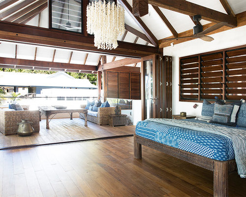 Design Ideas For A Tropical Bedroom In Cairns With White Walls, Dark  Hardwood Floors And
