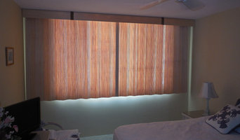 Split draw sliding woven wood treatments over a sliding glass window can be a ni