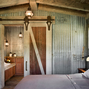 Example Of A Country Dark Wood Floor Bedroom Design In Other With Gray Walls