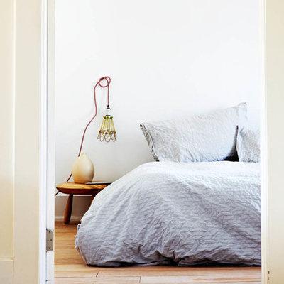 Bedroom - eclectic bedroom idea in Toronto with white walls