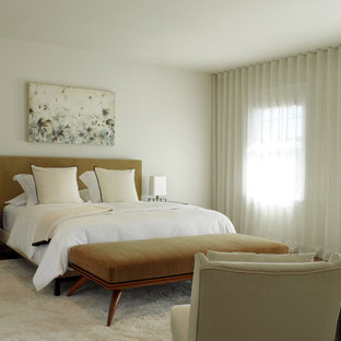 Inspiration for a contemporary medium tone wood floor bedroom remodel in San Francisco with white walls and no fireplace