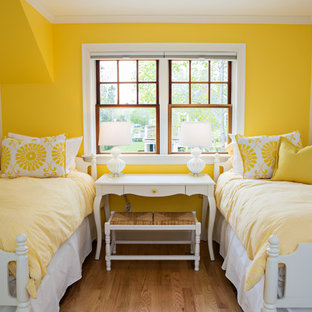 Inspiration for a mid-sized transitional guest medium tone wood floor and brown floor bedroom remodel in Boston with yellow walls and no fireplace