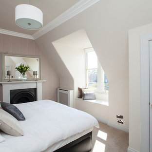 Inspiration for a traditional bedroom in Edinburgh with beige walls, carpet and a standard fireplace.