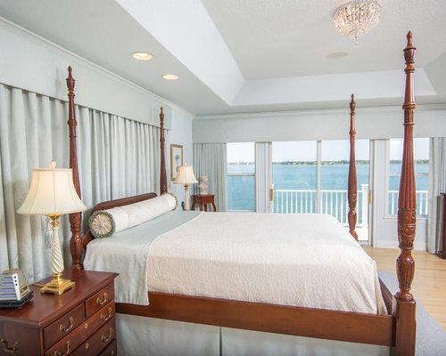 Bedroom   Traditional Light Wood Floor And Beige Floor Bedroom Idea In  Jacksonville With Blue Walls