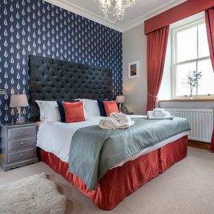 Photo of a traditional guest bedroom in Other with blue walls, carpet and beige floors.