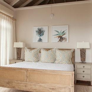 Tropical master bedroom in Other with beige walls, medium hardwood floors, no fireplace and brown floor.