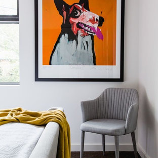 This is an example of a small midcentury bedroom in Melbourne with white walls and carpet.