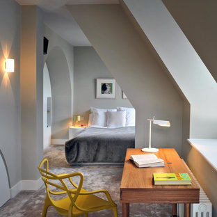 Inspiration for a mid-sized contemporary bedroom in London with grey walls and carpet.