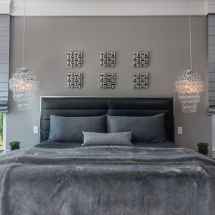 Mid-sized trendy master laminate floor and gray floor bedroom photo in Tampa with gray walls