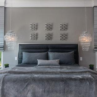 Inspiration för ett mellanstort funkis huvudsovrum, med grå väggar, laminatgolv och grått golv