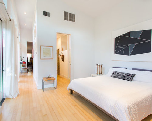 Bedroom Designs Interior. Example of a trendy master light wood floor and beige bedroom design  in New Orleans Top 100 Contemporary Bedroom Ideas Decoration Pictures Houzz