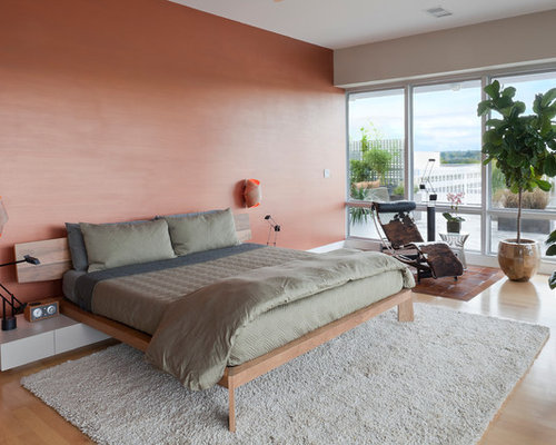 Inspiration for a large contemporary master light wood floor bedroom remodel in New York with pink : cowhide chaise lounge - Sectionals, Sofas & Couches