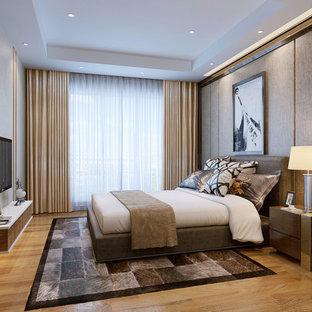 Imagen de habitación de invitados contemporánea, grande, con paredes multicolor y suelo de contrachapado