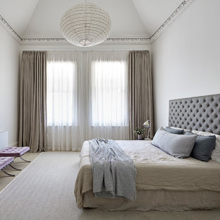 Design ideas for a contemporary master bedroom in Melbourne with white walls, light hardwood floors and beige floor.