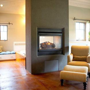 Idéer för att renovera ett eklektiskt sovrum, med en spiselkrans i betong och en dubbelsidig öppen spis