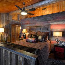 Rustic Bedroom by Lake Country Builders