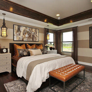 Example of a transitional dark wood floor bedroom design in Orlando with brown walls and no fireplace